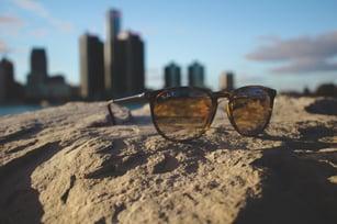 sunglasses on rock-2